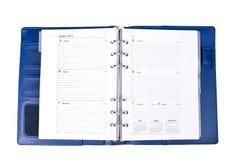 Esconda comprobó el calendario del cuaderno aislado en el fondo blanco Imagen de archivo libre de regalías