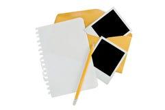 Esconda la nota y las fotos inmediatas Imagenes de archivo