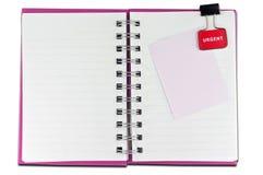 Esconda un cuaderno del Libro Blanco de la cara imagen de archivo libre de regalías