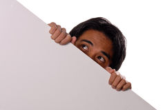 Esconder atrás de uma parede Fotos de Stock Royalty Free