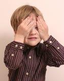 Esconder do menino Imagens de Stock