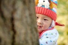 Escondite del juego del bebé Fotos de archivo libres de regalías