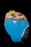 Escorca Sa Calobra view from a cave in Mallorca. Balearic island with anchor sailboats Royalty Free Stock Image