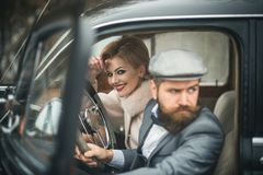 Escort of girl by security. escort concept with bearded driver and luxury girl in retro car. Escort of girl by security. escort concept with bearded driver and stock photography