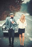 Escort of girl by security. escort concept with bearded driver and luxury girl in retro car. stock image