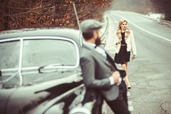 Escort of girl by security. Travel and business trip or hitch hiking. Couple in love on romantic date. Retro collection. Car and auto repair by mechanic driver royalty free stock images