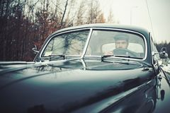 Escort man or security guard. Travel and business trip or hitch hiking. Bearded man in car. Call boy in vintage auto stock images