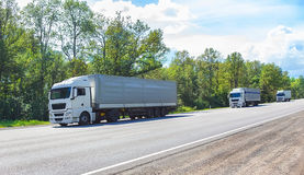 escort of trucks on country Royalty Free Stock Photography