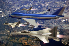 Escorted plane. From the porthole of a plane, view of a 747 Boeing escorted by several fighters F15 over Greenwich Bay, Rhode Island, USA Royalty Free Stock Image