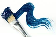 Escova com pintura azul Imagem de Stock Royalty Free