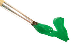 A escova com pintura verde no branco escreve v Fotografia de Stock Royalty Free