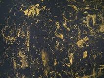 Escova da textura do grunge do ouro no fundo preto do sumário da cor Imagem de Stock