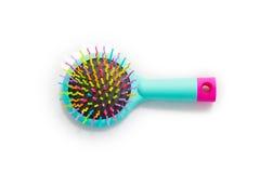 Escova de cabelo brilhante da massagem em um fundo branco é Imagem de Stock Royalty Free