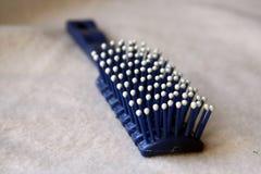 Escova de cabelo plástica Fotos de Stock Royalty Free