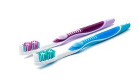 Escova de dentes colorida dos dispositivos da higiene isolada Imagem de Stock Royalty Free