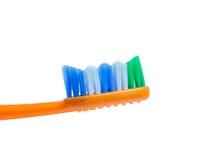Escova de dentes colorida laranja imagem de stock