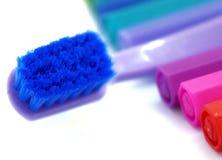 Escova de dentes do toque macio no fundo colorido e branco Imagens de Stock Royalty Free