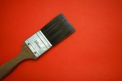 Escova de pintura com fundo vermelho Imagens de Stock Royalty Free
