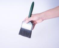 escova de pintura com mão escova de pintura com mão em um fundo Imagens de Stock Royalty Free