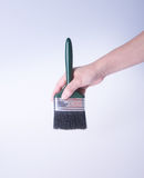 escova de pintura com mão escova de pintura com mão em um fundo Fotografia de Stock Royalty Free