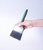 escova de pintura com mão escova de pintura com mão em um fundo Imagem de Stock