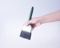 escova de pintura com mão escova de pintura com mão em um fundo Imagens de Stock