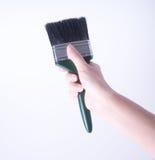 escova de pintura com mão escova de pintura com mão em um fundo Imagem de Stock Royalty Free