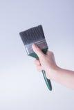 escova de pintura com mão escova de pintura com mão em um fundo Fotos de Stock