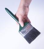 escova de pintura com mão escova de pintura com mão em um fundo Fotos de Stock Royalty Free