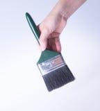 escova de pintura com mão escova de pintura com mão em um fundo Foto de Stock