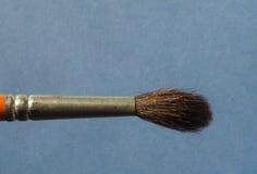 Escova de pintura sobre o papel Foto de Stock