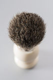 Escova de rapagem isolada no fundo cinzento Imagem de Stock