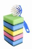 Escova do prato com esponjas Foto de Stock Royalty Free