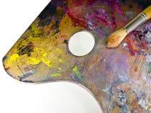 Escova e paleta com pinturas de óleo Foto de Stock Royalty Free