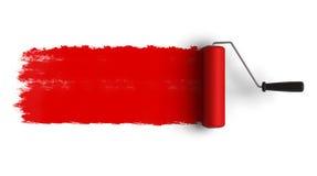 Escova vermelha do rolo com a fuga da pintura Foto de Stock Royalty Free