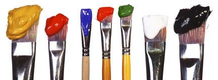 Escovas com pintura Imagem de Stock