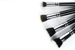 Escovas da composição no fundo branco Imagens de Stock Royalty Free