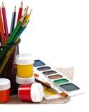 Escovas de pintura com pintura Imagem de Stock