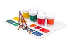 Escovas de pintura com pintura Imagem de Stock Royalty Free