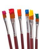 Escovas de pintura com pintura Fotos de Stock Royalty Free