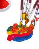 Escovas de pintura com pintura Foto de Stock