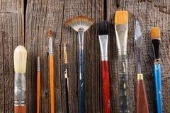 Escovas de pintura de Aristic Foto de Stock