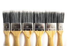 Escovas de pintura em seguido Imagens de Stock Royalty Free