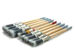Escovas de pintura em seguido Fotografia de Stock Royalty Free