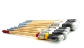 Escovas de pintura em seguido Foto de Stock Royalty Free