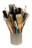 Escovas de pintura em uma lata Foto de Stock