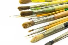 Escovas de pintura no fundo branco Foto de Stock