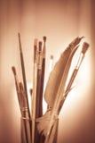 Escovas de pintura no potenciômetro Imagens de Stock Royalty Free