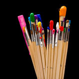 Escovas de pintura no preto Fotografia de Stock