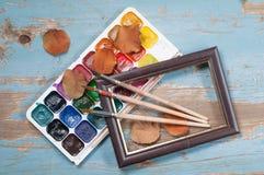 Escovas de pintura, pintura e outono do quadro Imagem de Stock